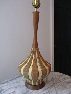 """""""Harlequin"""": citrus, sand, cream ceramic. Wooden neck and base. 22""""H."""