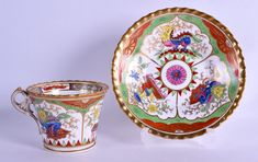 Early 19th c. Chamberlains Worcester teacup and saucer painted with the Dragon in Compartments pattern. 19th Century English tea cup and saucer. Asian theme decoration.