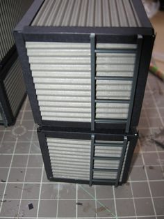 A tutorial on how to build scratch built shipping containers for Warhammer 40k and Necromunda. A step by step tutorial showing how to build your own terrain from basic materials.
