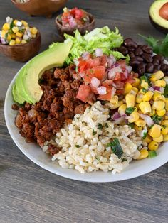 Who doesn't love burrito bowls? Here is my healthier version of Chipotle's bowl, corn salsa and all. I used Beyond Meat to keep it vegan, yet still hearty, and brown rice in place of white for the cilantro lime rice. Vegetarian Burrito, Vegan Burrito Bowls, Vegetarian Recipes Dinner, Veggie Recipes, Whole Food Recipes, Dinner Recipes, Healthy Recipes, Vegan Bowl Recipes, Vegan Chipotle Bowl