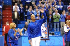 Senior guard Travis Releford waves to the crowd before the match against Texas Tech Monday night March 4 in Allen Fieldhouse for senior night. Releford had 13 total points with five rebounds contributing in the 79-52 defeat against the Red Raiders.