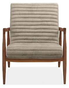 This striking leather accent chair has details you'll appreciate from every angle. Callan's contoured seat and back seem to float inside the frame, while horizontal channels add extra comfort. The solid wood frame offers an elegant profile with its soft curves and sophisticated tapered shape. It's a perfect place to relax.