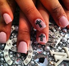 Pink nails with black cross