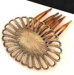 https://www.ebay.com/itm/Vintage-Hair-Comb-Antique-Gold-Tone-Ornate-Design-Bridal-RARE-Never-Worn-13D/263559508109?hash=item3d5d5ef08d:g:nREAAOSwKyRasDf3