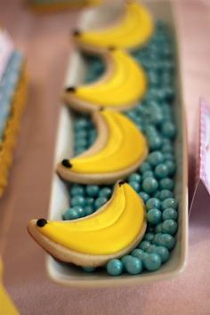 curious george inspired monkey party food and treats, banana cookies and sixlets