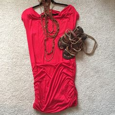 HOST PICK 🍾 Bright red Bella D cotton dress So cute and versatile. It easy to pack and to dress up or down. length 36.5 inches. Says it fits a large, but because it's so stretchy, it could definitely fit a small/medium a little looser too. 96%rayon, 4% spandex. Has belt loops, but no belt included. Back has fun cut out to wear cool bra or bandeau! I'm modeling maternity if you want to wear maternity, but it's not technically a maternity dress. Hope you love this! Bella D Dresses Mini