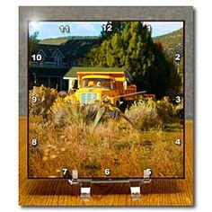 An old truck sitting on a piece of property in Pine Valley, Utah Desk Clock