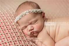This pretty, little, handmade headband is complete with floral accents and natural elements, which is the perfect item for your client or little girl!  www.customphotoprops.com