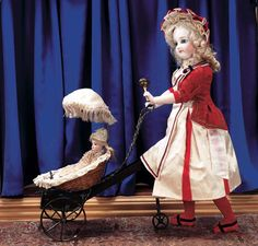"""Theriault's Antique Doll Auctions - Early Bisque Mechanical Walking Lady with Carriage and Mignonette 17"""" - Attributed to Vichy, circa 1875"""