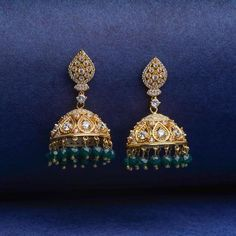 Graceful and traditional Jhumka Earrings meticulously crafted with Austrian crystals, Cultured Venetian Pearl, faux Ruby and Emerald stones and 18K Yellow Gold plating. Traditional jewellery for women. Women Fashion Jewellery online. Ethnic wear earrings online. Earrings For Saree, Gold Jhumka Earrings, Girls Earrings, Statement Earrings, Women's Earrings, Diamond Earrings, Earrings Online, Traditional Earrings, Fashion Jewellery Online