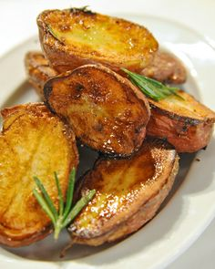 "Basic new potatoes are baked with fresh rosemary in this simple side dish from Glamour magazine's ""100 Recipes Every Woman Should Know"" cookbook. Pair with classic meat dishes, like roasted Engagement Chicken."