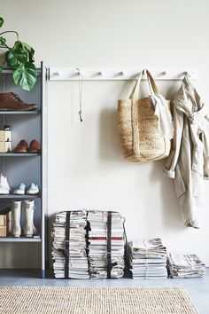 A coat rack - like the IKEA KUBBIS rack with 7 hooks - is an easy way to add some organization to your entryway without taking up floor space!