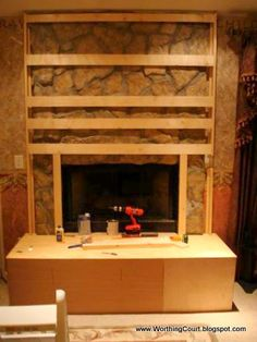Worthing Court: DIY Fireplace Makeover  Don't care for the finished product, but this may be a way to cover ours.