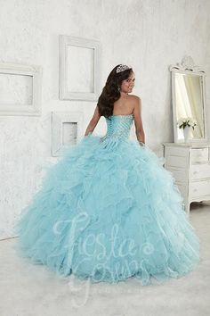 Designed for your dream 15 is this delightful ball gown with scallop pattern beading, lace-up back, sweetheart neckline, and organza ruffled skirt with wired edging. Download the Fiesta Gowns by House
