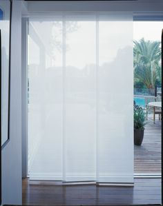 Panel Glide - For a touch of modern sophistication, Luxaflex Panel Glide blinds offer a contemporary take on traditional Window Fashions.