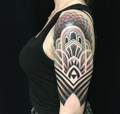 This masterpiece tattoo still in progress is incredible and perfectly captures the art deco design of that era.