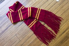Harry Potter Scarf :) Mine will be blue and grey obviously (mostly just because I couldn't find a bronze that I liked so I opted for movie colors...) Harry Potter Scarf Pattern, Harry Potter Gryffindor Scarf, Ravenclaw Scarf, Harry Potter Movie Posters, Knitting Blogs, Knitting Scarves, Scarf Knit, How To Purl Knit, Knit Purl