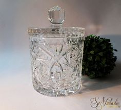 Large cut crystal lidded jar. HEAVY quality vintage crystal glass biscuit,- cookie,- candy,- bon-bon,- storage jar with cover. Pinwheel, starburst pattern etc., and a touch of etch work. Vintage and stylish item in good condition. On offer by SoVintastic on Etsy