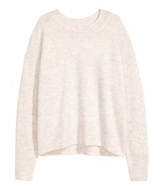 Light beige melange. Oversized sweater in a soft, fine knit with wool content. Dropped shoulders, ribbing at neckline, cuffs, and hem, and slightly longer