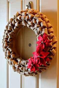 Burlap Wreath 15. Made from burlap cut into squares, folded and glued or pinned in place on a styrofoam wreath.  You don't see all the frayed edges on this one!