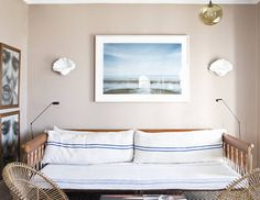 {balance it out When decorating a wall with furniture, set the bottom of the picture six to eight inches above the sofa. Add some supportive decorative touches on both sides to pull the look together.}