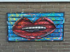Garden Art (all season): SUMMER SMILE, 53 x 104, recycled wood, bicycle tube and acrylic paint