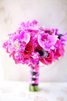 Purple stock, roses, cala lilies, and phalaenopsis