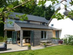 Contemporary Wood Room extension to thatched cottage in Exmoor National Park