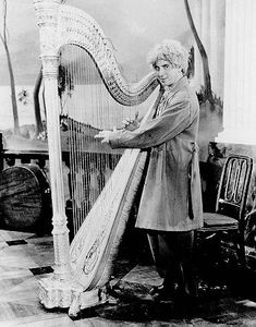 Harpo at his harp -  He was a serious harpist and could play quite beautifully