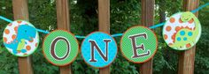 Listing is for a dinosaur age banner spelling out ONE and featuring two cute dinosaur cut outs and colors of orange green and blue turquoise. Matching Birthday Banner can be found here: http://etsy.me/1Hhwet7 Matching Photo banner can be found here : http://etsy.me/1dkrpbi  The triple layered panels are 4.5, are adjustable, include a double layered number, and are joined with a 1/4 satin ribbon ... with a generous 18 heat sealed tail on either end.  Will shi...
