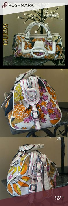 GUC Vintage Guess Floral Satchel Very cute floral canvas Guess brand bag in good condition for vintage. Has been professionally cleaned with no odors. No rips, holes, or snags in fabric. Interior has ink stains in bottom and heavy makeup stains in side zip pocket. Exterior vinyl next to main zip has 6 small snags. Handle threading has light wear but handle are in great shape. We have priced this bag to its imperfections. Thank you for visiting my closet ❤ Guess Bags Satchels