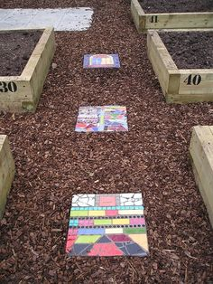 Love the stepping stones, but love the raised and numbered flower/veggie beds.