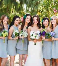 Bridesmaids in gray dresses with teal flower headbands. Photo by Studio Castillero