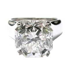 """6.11 carat diamond GIA graded F color and Internally Flawless. The diamond cut is by Tiffany, called """"Lucida"""". The band is a Tiffany & Co wide solitaire band. Can be sized. Other 6 and 7 carat diamond rings available. 274k USD"""