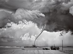 "Photograph by Mitch Dobrowner Regan, North Dakota A dying tornado like this one is said to be in the ""roping out"" phase."