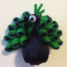 Mr. Peacock ribbon sculpture hair clip! the lady i buy tyleigh and addi's hair bows form made this! it's amazing!