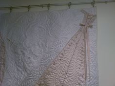 Back Porch Quiltworks: Heirloom wedding dress quilt. Like how the whole back of the dress is displayed and quilted. If I was to ever do this it will be sent to someone to be quilted