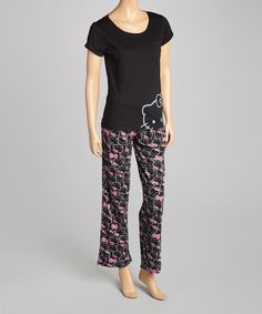 Hello Kitty meets hello bedtime with these ladies pajamas. Featuring a short-sleeve top and relaxed fit bottoms, these pj's make lounging around the house even more relaxing. Includes top and bottoms  Top measurements (size L): 26'' long from high point of shoulder to hemBottom measurements (size L): 29'' inseam