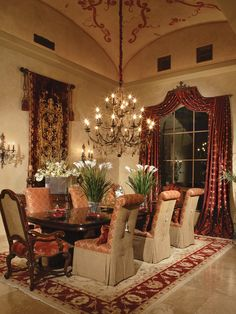 This room is filled in so nice and with such rich colors.  From the rug to the different chair types to the sparkly chandelier,this room makes you not want to leave.