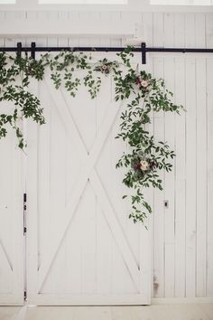 Foliage accented white barn wedding: http://www.stylemepretty.com/2016/03/31/rustic-white-sparrow-barn-wedding/ | Photography: Shaun Menary - http://shaunmenary.com/