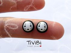 Little stud earrings inspired by Spirited Away movie of Miyazaki (Studio Ghibli) with character No Face. Realized in polymer clay. The polymer clay is