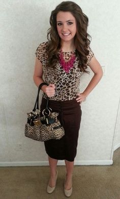 Brown skirt, animal print top, and a pop of color with statement necklace. Love it!