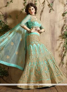 We have ensemble a symphony of enchanting piece to restyle your senses. Attract compliments by this sea green net a line lehenga choli. This ravishing attire is amazingly embroidered with embroidered ...