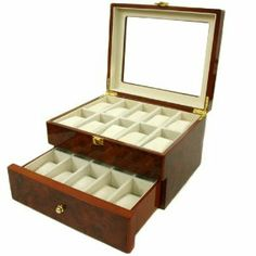 "Luxury Watch Storage Chest For 20 Watches Burlwood Finish Glass See-Thur Lid Latch Tech Swiss. $79.95. Watch Box For 20 Timepieces. Box Dimensions 11"" L x 9"" Wx 6.50""H. Compartment Size: 4.00"" L x 1.75"" W x 2.75""H. Extra Clearance For Large Watches (Fits Watches Cases Up to 43mm). Glass Display Window with Gold Tone Hardware Latch"