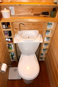 "smallhousecatalog.com ""The tiniest room in our tiny house has room for a porcelain toilet or a manufactured composting toilet (or a bucket & sawdust).""- I like the recycled sink water design of this toilette."