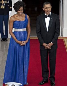 May 2010---Mrs. Obama waited with the President to greet Mexican President Felipe Calderon and his wife in a Peter Soronen cobalt blue, one shoulder dress.   - HarpersBAZAAR.com