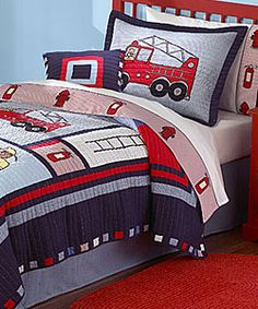 Fire trucks, ladders and hydrants adorn this adorable three-piece quilt set. Available in a variety of sizes to suit your needs, this kids' set includes a quilt and coordinating pillow shams. Bedding