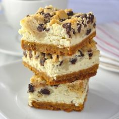 Chocolate Chip Cookie Dough Cheesecake Bars - the holy grail of cookie bars; a perfect caloric storm of flavor with a buttery graham cracker crumb crust, a vanilla cheesecake center and gobs of cookie dough on top. (chocolate and cheese cookie dough) Cookie Dough Cheesecake, Cheesecake Recipes, Cookie Recipes, Dessert Recipes, Cookie Bars, Dessert Ideas, Cheesecake Squares, Baking Recipes, Just Desserts