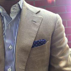 bold blue strip, cream jacket and pocket square