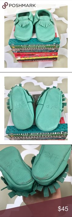 ✳️New Listing✳️ FreshlyPicked Aqua Mocs size 4 FreshlyPicked Mocs in Aqua. These have slight wearing on the heels (can't see when worn) and a small scuff on the toe. Otherwise they are in very good used condition. Fringe looks great. Freshly Picked Shoes Moccasins